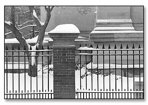 Detail of snow, fence & the John Carter Brown Library. <br>Brown University, Providence, Rhode Island. December 1995.