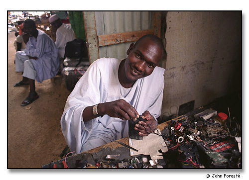 Camera repairman in market. <br>Maroua, Cameroon, (central west) Africa. August 2002.
