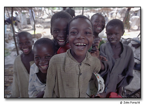Laughing boys on market day. <br>Mora, Cameroon, (central west) Africa. August 2002.