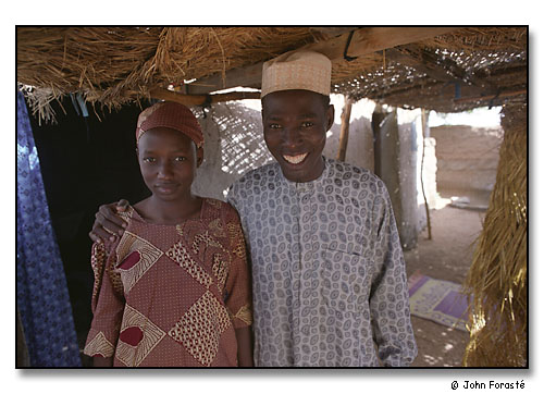 Young couple, Mahamma Bello & Amma (his wife of a few months) outside their house. Mora, Cameroon, (central west) Africa. August 2002.